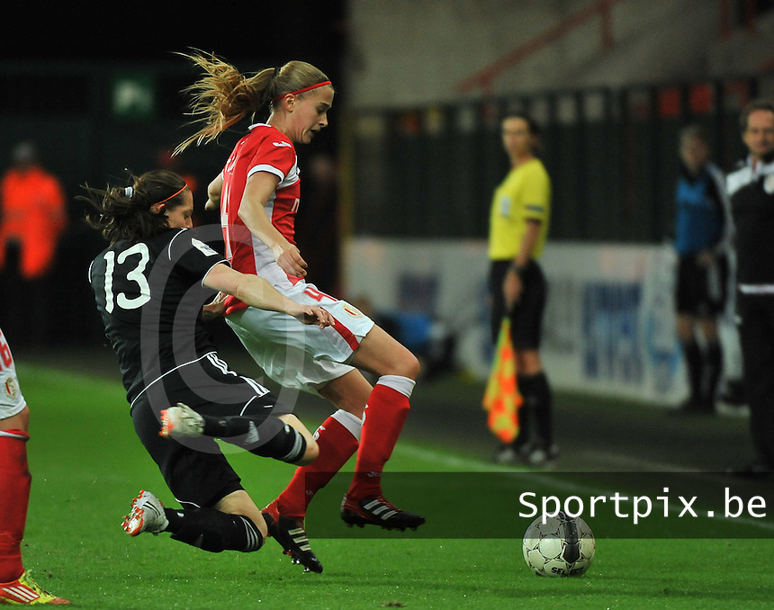 20131009 - LIEGE , BELGIUM : Standard's Julie Biesmans (4) pictured being tackled by Glasgow Suzanne Malone during the female soccer match between STANDARD Femina de Liege and  GLASGOW City LFC , in the 1/16 final ( round of 32 ) first leg in the UEFA Women's Champions League 2013 in stade maurice dufrasne - Sclessin in Liege. Wednesday 9 October 2013. PHOTO DAVID CATRY