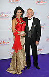 Bruce Forsyth and wife Wilnelia Merced   The Caudwell Children Diamond Butterfly Ball at Battersea Evolution London, England  30/05/2012 Picture By: Brian Jordan / Retna Pictures. .-.