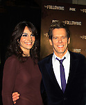 """Guiding Light's Kevin Bacon """"Tim Werner"""" (Search For Tomorrow) poses with As The World Turns' Annie Parisse """"Julia"""" as they star in """"The Following"""", Fox's new tv series on Mondays and Kevin's first tv series, which held its world premiere on January 19, 2013 at the New York Public Library, New York City, New York. The characters they play are: Kevin - FBI agent """"Ryan Hardy"""", Annie - (Kevin's) right hand FBI agent """"Debra Parker"""" and Natalie - """"Claire Matthews"""" who is the love interest of """"Ryan"""" and ex-wife of """"serial killer"""" James Purefoy. (Photo by Sue Coflin/Max Photos)"""