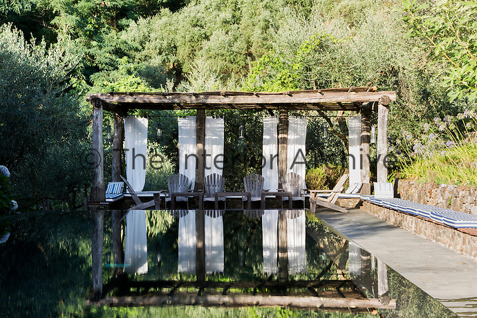 The mirror pool with a pergola to the rear is a stunning feature of the secluded garden.