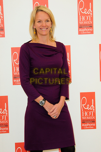 ELISABETH MURDOCH.attends Red magazine's 'Red Hot Women Awards' at the Saatchi Gallery, London, England, UK, .November 30th 2010..half length purple aubergine dress wrist watch smiling long sleeve .CAP/CAS.©Bob Cass/Capital Pictures.