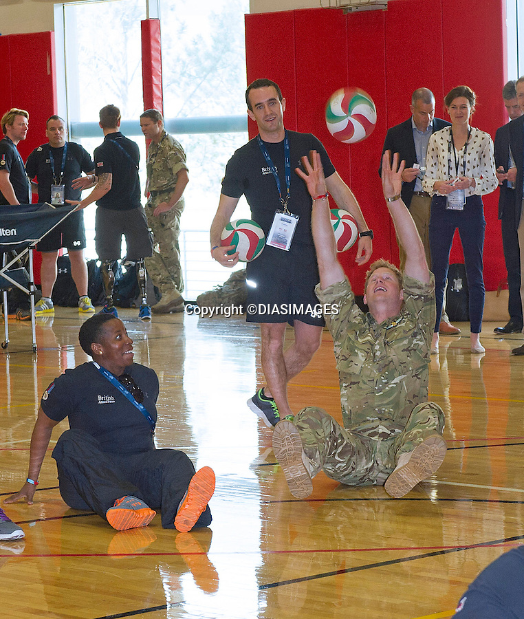 """PRINCE HARRY.plays seating volleyball with members of his team during the Warrior Games in Colorado Springs, Olympic Park_11/05/2013.Prince Harry is on a week long USA visit the includes Washington, Denver, Colorado Springs, New Jersey, New York and Conneticut..Mandatory credit photo:©DIASIMAGES..(Failure to credit will incur a surcharge of 100% of reproduction fees)..**ALL FEES PAYABLE TO: """"NEWSPIX  INTERNATIONAL""""**..Newspix International, 31 Chinnery Hill, Bishop's Stortford, ENGLAND CM23 3PS.Tel:+441279 324672.Fax: +441279656877.Mobile:  07775681153.e-mail: info@newspixinternational.co.uk"""
