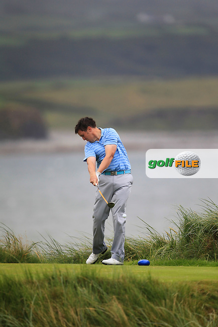 Paul O'Hara (Kilkenny) with his caddie on the 7th tee during the South of Ireland Amateur Open Championship Final at Lahinch Golf Club  31th July 2013 <br /> Picture:  Thos Caffrey / www.golffile.ie