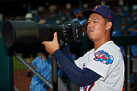 Jacksonville Jumbo Shrimp pitcher Jordan Yamamoto (23) takes photos with a Nikon D5 and 400mm lens before a Southern League game against the Mobile BayBears on May 28, 2019 at Baseball Grounds of Jacksonville in Jacksonville, Florida.  Mobile defeated Jacksonville 2-1.  (Mike Janes/Four Seam Images)