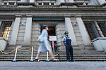A security guard monitors the entrance of the Bank of Japan (BOJ) on September 21, 2016, Tokyo, Japan. The Bank of Japan (BOJ) announced it would modify its monetary policy framework on Wednesday by expanding the monetary base until inflation is stable above the 2% target it set more than three years ago. It also said that it would aim to keep yields on 10-year government bonds at current levels around zero percent. In reaction to Japan's central bank decision the Nikkei 225 Stock Average closed up 1.91 percent to 16,807.62. (Photo by Rodrigo Reyes Marin/AFLO)
