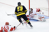 Nick Bonino (BU - 13) earned a minor for tripping after Chris Barton (Merrimack - 23) had a shorthanded breakaway on Grant Rollheiser (BU - 35). - The Boston University Terriers defeated the Merrimack College Warriors 6-4 on Saturday, November 14, 2009, at Agganis Arena in Boston, Massachusetts.