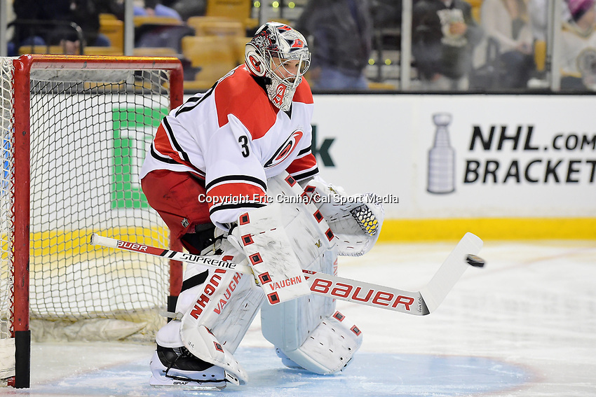 Tuesday, April 5, 2016: Carolina Hurricanes goalie Cam Ward (30) stops the puck during the warm up period at the National Hockey League game between the Carolina Hurricanes and the Boston Bruins held at TD Garden, in Boston, Massachusetts. Eric Canha/CSM