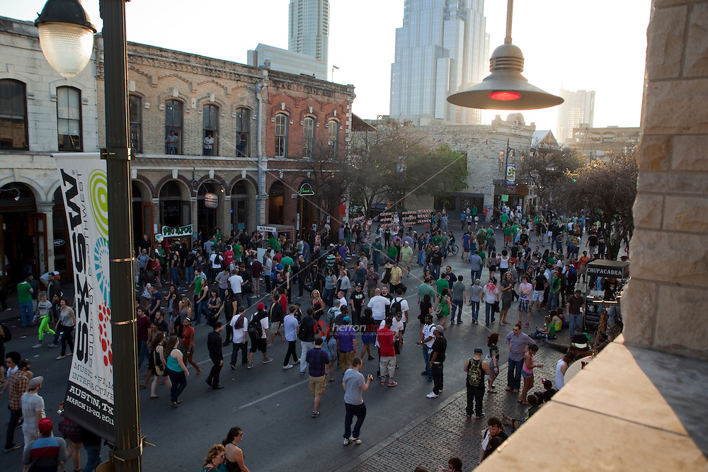 SXSW patrons pack the streets to celebrate St. Patrick's Day on 6th Street in Austin, Texas