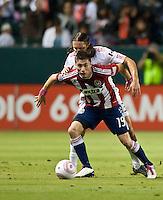 Chivas USA midfielder Jorge Flores shields Toronto FC defender Nana Attakora during the first half of the game between Chivas USA and Toronto FC at the Home Depot Center in Carson, CA, on October 9, 2010. Final score Chivas USA 3, Toronto FC 0.