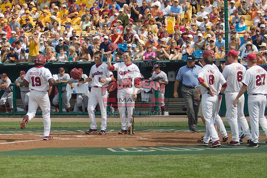South Carolina's Jackie Bradley Jr. is greeted by his teammates after hitting a home run in Game 7 of the NCAA Division One Men's College World Series on Monday June 22nd, 2010 at Johnny Rosenblatt Stadium in Omaha, Nebraska.  (Photo by Andrew Woolley / Four Seam Images)