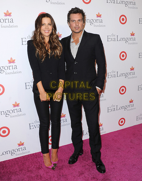 Kate Beckinsale and Len Wiseman<br /> attends The Annual Eva Longoria Foundation dinner held at Beso in Hollywood, California, USA, September 28th 2013.<br /> full length jacket suit husband wife couple clutch bag blazer black trousers pink toe cap gold shoes                                                                     <br /> CAP/DVS<br /> &copy;Debbie VanStory/Capital Pictures