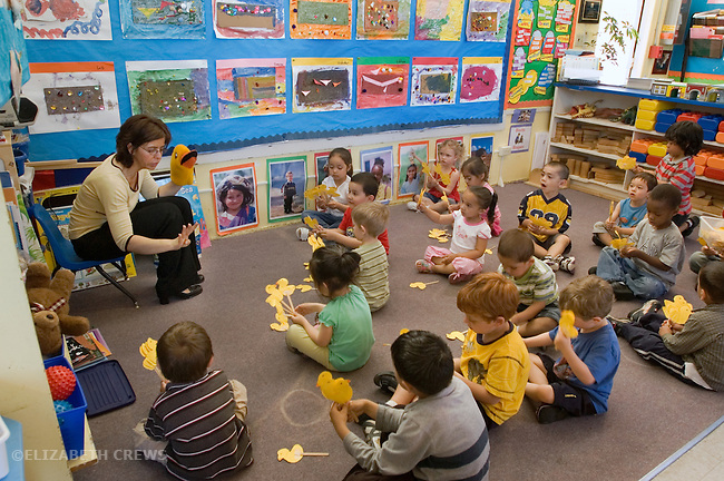 Berkeley CA Teacher in Spanish-English bilingual preschool using hand puppet  and manipulatives to teach students counting.