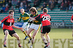 Kerry's Donnacha Walsh and UCC's l-r: Bart Daly Peter Crowley.
