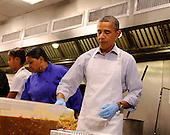 United States President Barack Obama with daughter Malia Obama, and Marianne Ali, participate in a service project at DC Central Kitchen, on Saturday, September 10, 2011, in Washington, DC.  .Credit: Leslie E. Kossoff / Pool via CNP