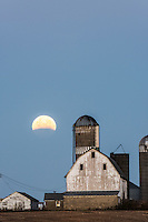 Lunar eclipse over farm buildings near Shakopee, Minnesota.