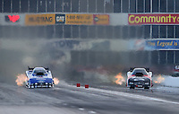 Apr. 26, 2013; Baytown, TX, USA: NHRA funny car driver Robert Hight (left) races alongside Blake Alexander during qualifying for the Spring Nationals at Royal Purple Raceway. Mandatory Credit: Mark J. Rebilas-