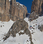 Gondola ascends from Passo Pordoi to the Sella Groupa, Dolomites, Italy