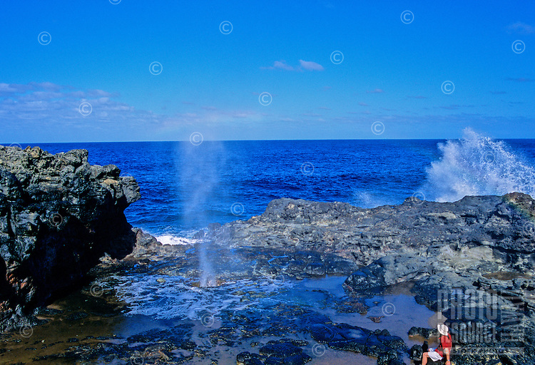 Tourist watches the Nakalele blowhole