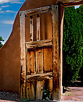 Wooden door, entry to the famous Santuario (healing chapel) at Chimayo , New Mexico
