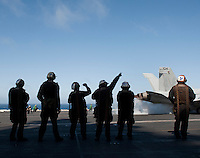 120522-N-DR144-661 .PACIFIC OCEAN (May 21, 2012) Plane captains assigned to Strike Fighter Squadron (VFA) 22 bid farewell to a launching F/A-18F Super Hornet as pilots and aircraft assigned to Carrier Air Wing (CVW) 17 depart the flight deck of the Nimitz-class aircraft carrier USS Carl Vinson (CVN 70) and return to their home bases after nearly six months embarked. Carl Vinson and CVW 17 recently completed a deployment to the U.S. 5th and 7th Fleet areas of operations. (U.S. Navy photo by Mass Communication Specialist 2nd Class James R. Evans/Released).