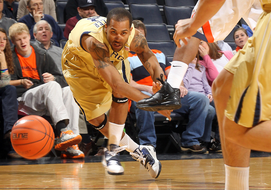 Jan. 22, 2011; Charlottesville, VA, USA; Georgia Tech Yellow Jackets guard Maurice Miller (3) looses control over the ball during the game against the Virginia Cavaliers at the John Paul Jones Arena. Mandatory Credit: Andrew Shurtleff-US PRESSWIRE