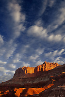731350014 clouds from clearing storm form up over the red sandstone formations of the waterpocket fold in capitol reef national park in utah
