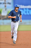 Asheville Tourists first baseman Jacob Bosiokovic (21) rounds the bases after hitting a home run during a game against the Hickory Crawdads at McCormick Field on July 13, 2017 in Asheville, North Carolina. The Tourists defeated the Crawdads 9-4. (Tony Farlow/Four Seam Images)
