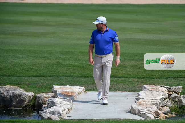 Graeme McDowell (NIR) walks across the bridge as he approaches the green on 18 during day 3 of the Valero Texas Open, at the TPC San Antonio Oaks Course, San Antonio, Texas, USA. 4/6/2019.<br /> Picture: Golffile | Ken Murray<br /> <br /> <br /> All photo usage must carry mandatory copyright credit (© Golffile | Ken Murray)