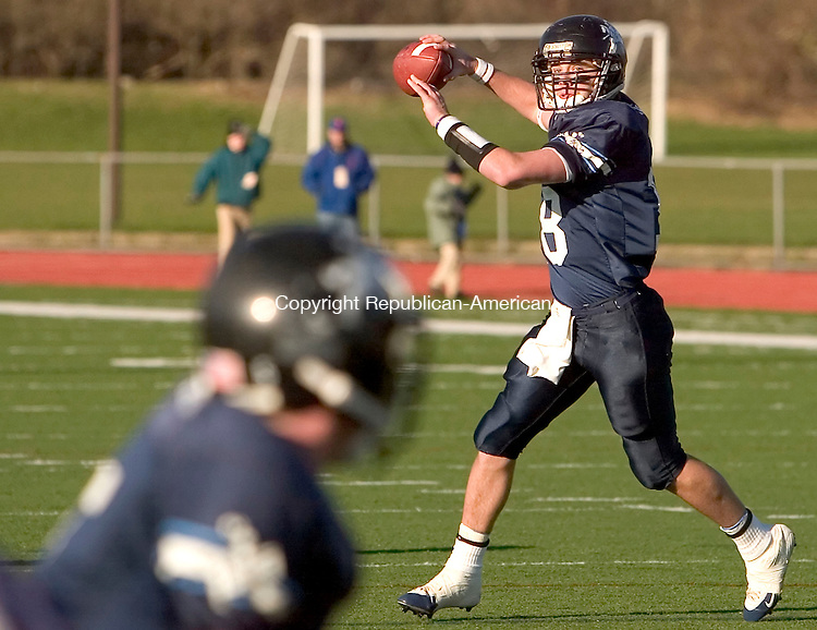 NEW HAVEN, CT- 03 DECEMBER 200-120306JS13-Ansonia's Taylor King tosses a pass into the endzone during their 34-12 win over Bloomfield in the Class S finals Saturday at Jess Dow Field on the SCSU campus in New Haven. <br /> Jim Shannon/Republican-American
