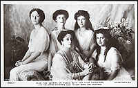 BNPS.co.uk (01202 558833)<br /> Pic: HAldridge/BNPS<br /> <br /> The Tsarina with her four daughters.<br /> <br /> Poignant photographs of the last Russian royal family visiting their British relatives - the King and Queen of Britain - have come to light.<br /> <br /> The black and white images show Tsar Nicholas II, his wife Alexander and their children at Osborne House on the Isle of Wight in 1909 with Edward VII and his wife, Mary of Teck.<br /> <br /> The images show just how close the two Royal families were. <br /> <br /> The album of up to 100 photo postcards is being sold for &pound;1,500 by Henry Aldridge and Son.