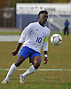 North Babylon No. 10 Kelichi Akujobi plays the ball near midfield during a Suffolk County varsity boys' soccer Class AA first round playoff game against Ward Melville at North Babylon High School on Tuesday, October 27, 2015. Ward Melville won by a score of 1-0.<br /> <br /> James Escher