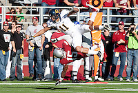 Tyree Toomer (15) prevents Michael Calvin (11) from making the catch. The University of California football defeated Washington State University 20-13 at Martin Stadium in Pullman, Washington on November 6th, 2010.
