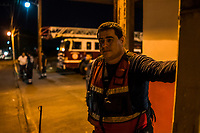 Journalist Jesus Olivares looks on at a Fire Station, where he volunteers part time, when he is not reporting, on June 29, 2016 in Veracruz, Mexico. <br /> Photo Daniel Berehulak for the New York Times