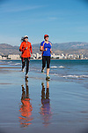 Women running near the Mediterranean sea