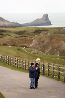 Pictured: Walkers pause to enjoy the view on the path that leads to Worm's Head (TOP). Monday 17 March 2014<br />