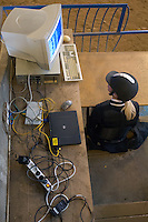 Rider checking her result on the computer screen. The computer system is temporary and messy but works well.<br /> Show jumping at Malmo Civila Ryttareforening in Malmo, Sweden.<br /> November 2007.<br /> Only for editorial use.