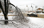 WINSTED, CT -03 January 2005 -010306JS07---Wednesday's heavy snow downed trees, broke limbs and caused power outages throught out the norther portion of the state. A large tree on the corner of Route 44 and Old Route 8 in Winsted, had a pair of branches break off.   Jim Shannon Republican American --  Remzi Arslan; Peter Nichols, James Benedetto, Winsted are CQ
