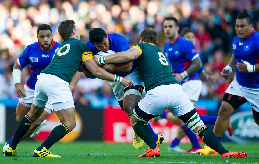 Samoa's Ofisa Treviranus is tackled by South Africa's Duane Vermeulen and South Africa's Handre Pollard<br /> <br /> Photographer Craig Thomas /CameraSport<br /> <br /> Rugby Union - 2015 Rugby World Cup Pool B  South Africa v Samoa - Saturday 26th September 2015 - Villa Park - Birmingham<br /> <br /> &copy; CameraSport - 43 Linden Ave. Countesthorpe. Leicester. England. LE8 5PG - Tel: +44 (0) 116 277 4147 - admin@camerasport.com - www.camerasport.com