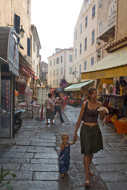 Woman and child walking, Street, Calvi, West Coast Corsica, Corsica, France, towns in Corsica, French coastal villages, Corsican coast,