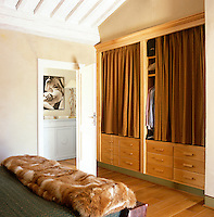 The main bedroom benefits from a built-in wardrobe and rows of neat storage drawers
