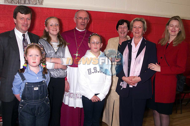 Sarah and Emma Foley from Waterunder who made thier confirmation in Mell church pictured with thier parents, Jimmy and Geraldine, sister Edel, Mary Gleeson, Catherine McCurtin and Bishop Sean Brady..Picture Paul Mohan Newsfile