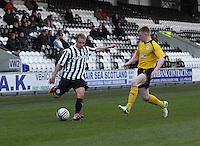 Sander Puri crosses before being closed down by Liam Rowan in the St Mirren v Falkirk Clydesdale Bank Scottish Premier League Under 20 match played at St Mirren Park, Paisley on 30.4.13. .