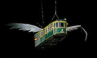 13 MAR 2006 - MELBOURNE, AUS - A Melbourne tram is lowered into the Melbourne Cricket Ground during the rehearsal for the Opening Ceremony of the 2006 Commonwealth Games .(PHOTO (C) NIGEL FARROW)