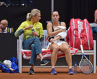 Netherlands, Den Bosch, April 18 2015 Maaspoort, Fedcup Netherlands-Australia,   Jarmila Gajdosova (AUS) on de beng with captain Alicia Molik<br /> Photo: Tennisimages/Henk Koster