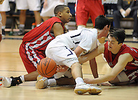 Lower Moreland's Danny Duffy (center), Holy Ghost's Julian Turner (left) and Holy Ghost's John McCrane battle for a loose ball in the third quarter of the District One Class AAA boys basketball championship game Saturday February 27, 2016 at Council Rock South in Northampton, Pennsylvania. (Photo by William Thomas Cain)