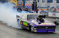 Oct. 31, 2008; Las Vegas, NV, USA: NHRA pro modified driver Joshua Hernandez does a burnout during qualifying for the Las Vegas Nationals at The Strip in Las Vegas. Mandatory Credit: Mark J. Rebilas-