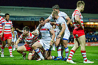 Picture by Allan McKenzie/SWpix.com - 17/04/2015 - Rugby League - Ladbrokes Challenge Cup - Wakefield Trinity Wildcats v Halifax RLFC - Rapid Solicitors Stadium, Wakefield, England - Wakefield's Ian Kirke is congratulated by Mickael Simon & Paul McShane on scoring.