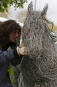 Friday, 17 May 2013, London, UK. Build-up to Chelsea Flower Show 2013, where floral displays and gardens are slowly taking place ahead of next week's show. Picture: Sculptur Laura Antebi working on a wire horse sculpture.