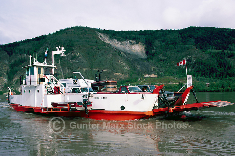 "Government Ferry ""George Black"" crossing Yukon River, Dawson City, YT, Yukon Territory, Canada"