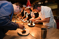 MELBOURNE, 30 June 2017 – Philippe Mouchel and Scott Pickett prepare a dish of duo of beef wagyu, pomme soufflé, cime di rapa and sauce Périgueux at a dinner celebrating Philippe Mouchel's 25 years in Australia with six chefs who worked with him in the past at Philippe Restaurant in Melbourne, Australia.